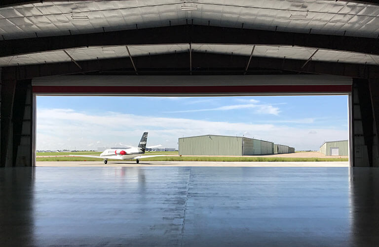 Overhead Doors on Airplane Hangar